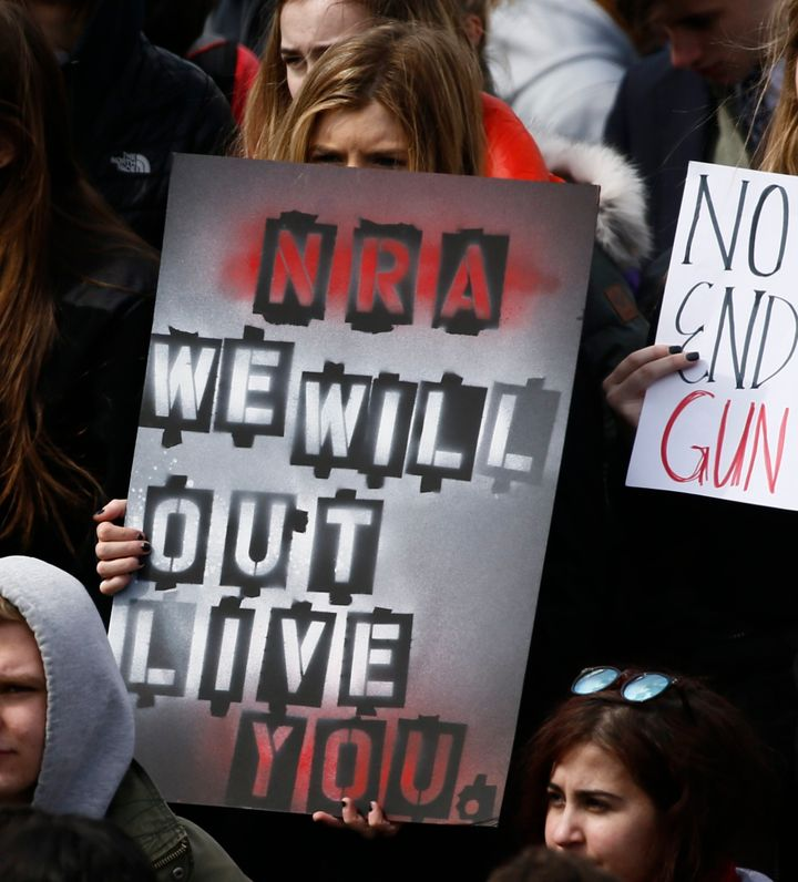 "A sign reading ""NRA We Will Out Live You"" is held during a protest in Washington, D.C. on Wednesday."