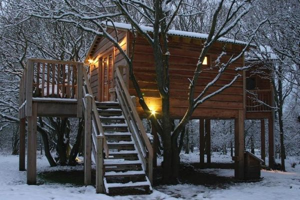 This treehouse is located in Whippingham, England, and provides a cozy escape for locals and tourists alike. It even includes