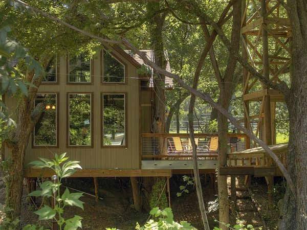This bright and cheery treehouse is more like a cabin and less like a bungalow. It has all the amenities you want out of your