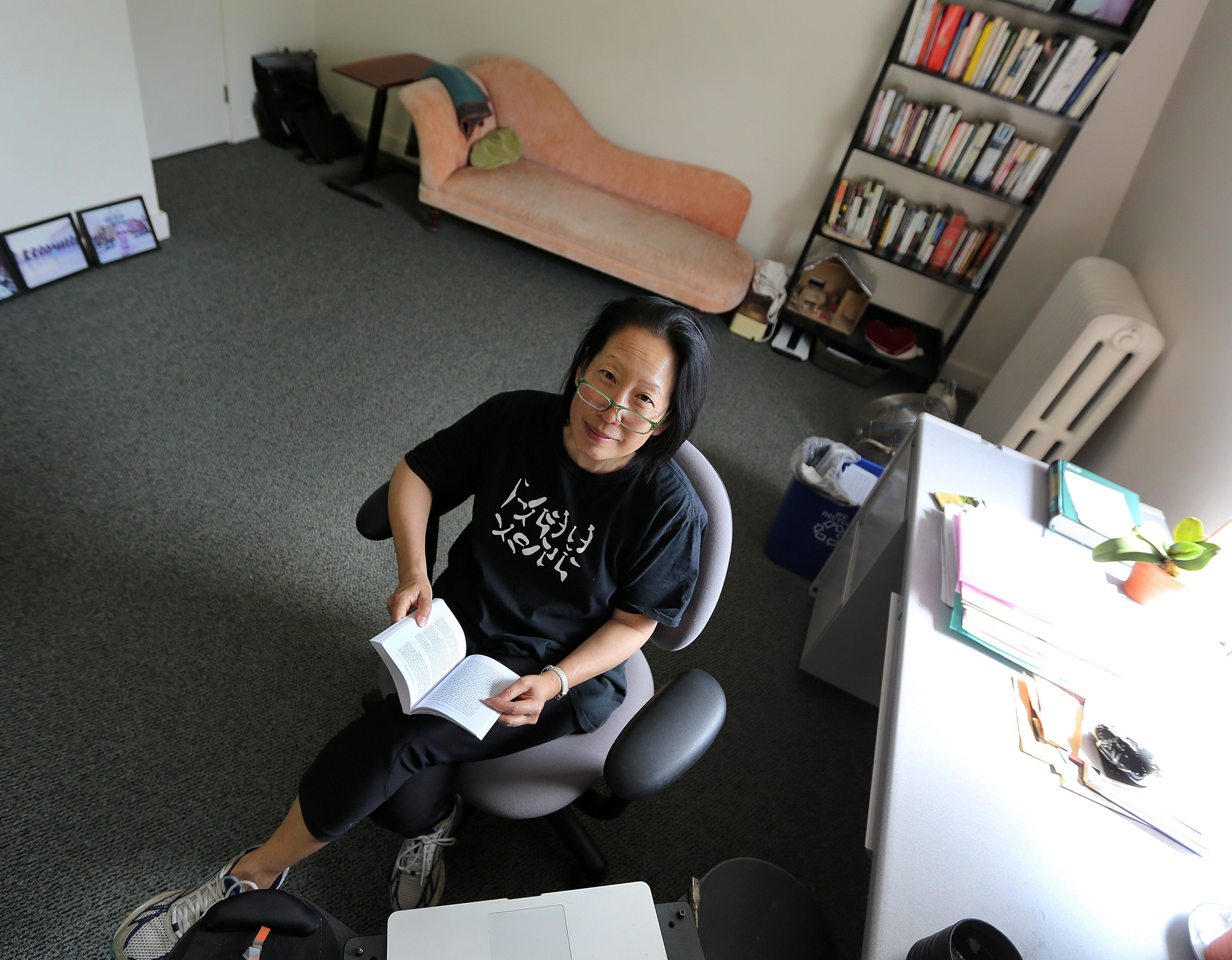 CAMBRIDGE, MA - MAY 28: Novelist Gish Jen works in her writing office in a Radcliffe building, on Tuesday, May 28, 2013.  It is equipped with a fainting couch and reading chair (not shown). (Photo by Pat Greenhouse/The Boston Globe via Getty Images)