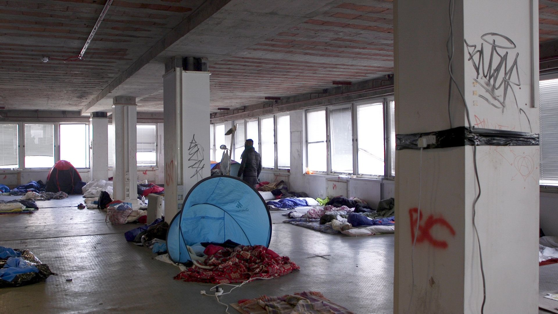 Tents and mattresses cover the floors of Sophia House