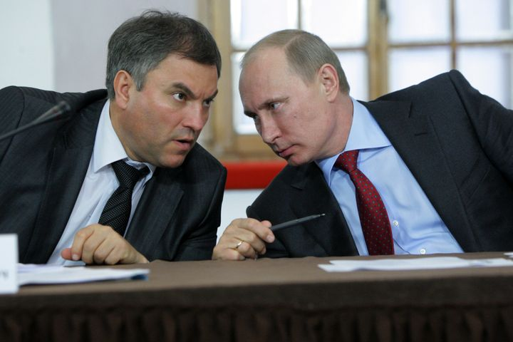 Putin talks to Vyacheslav Volodin in 2011.