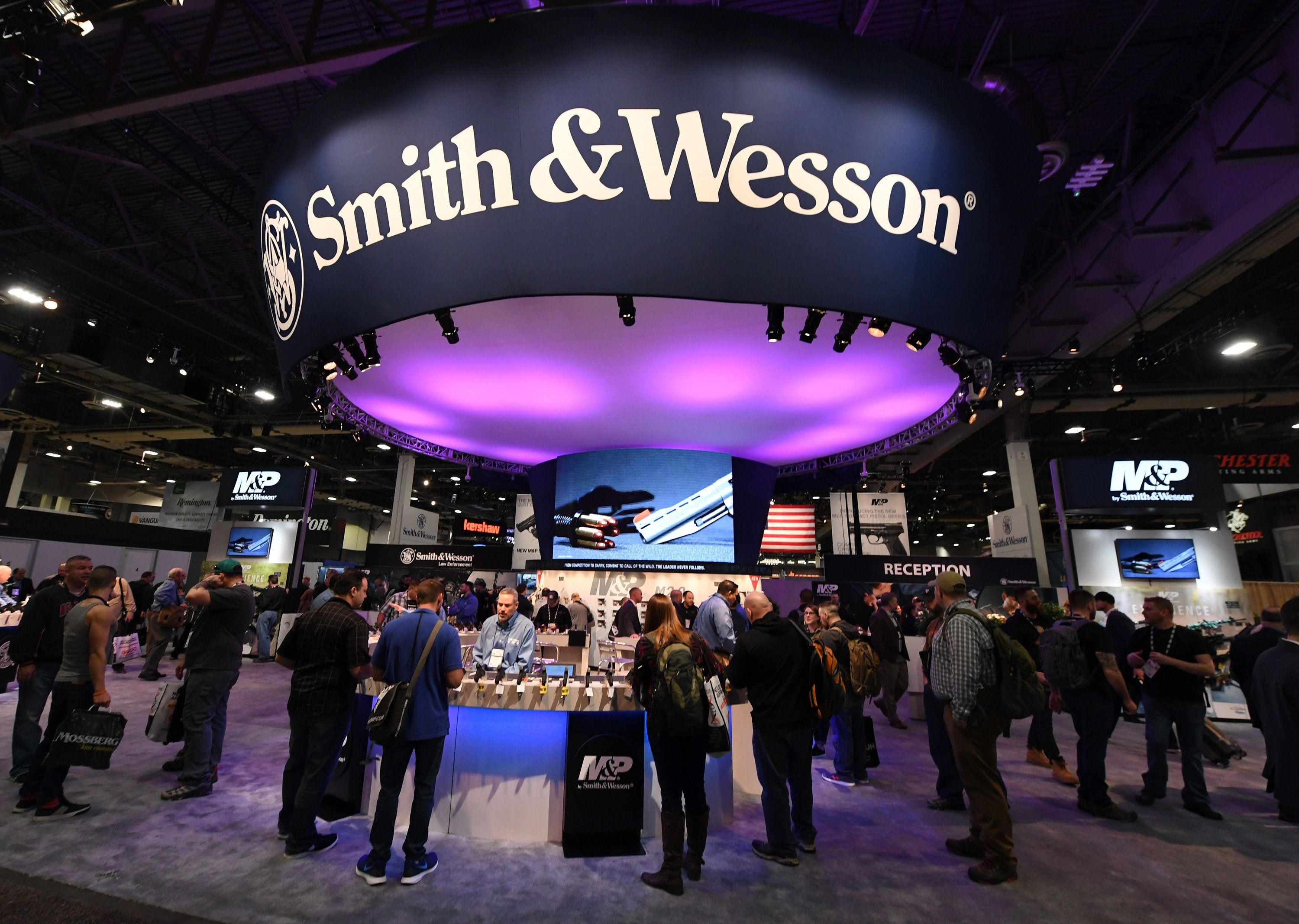 LAS VEGAS, NV - JANUARY 23:  Attendees visit the Smith & Wesson booth at the 2018 National Shooting Sports Foundation's Shooting, Hunting, Outdoor Trade (SHOT) Show at the Sands Expo and Convention Center on January 23, 2018 in Las Vegas, Nevada. The SHOT Show, the world's largest annual trade show for shooting, hunting and law enforcement professionals, runs through January 26 and is expected to feature about 1,600 exhibitors showing off their latest products and services to more than 60,000 attendees.  (Photo by Ethan Miller/Getty Images)