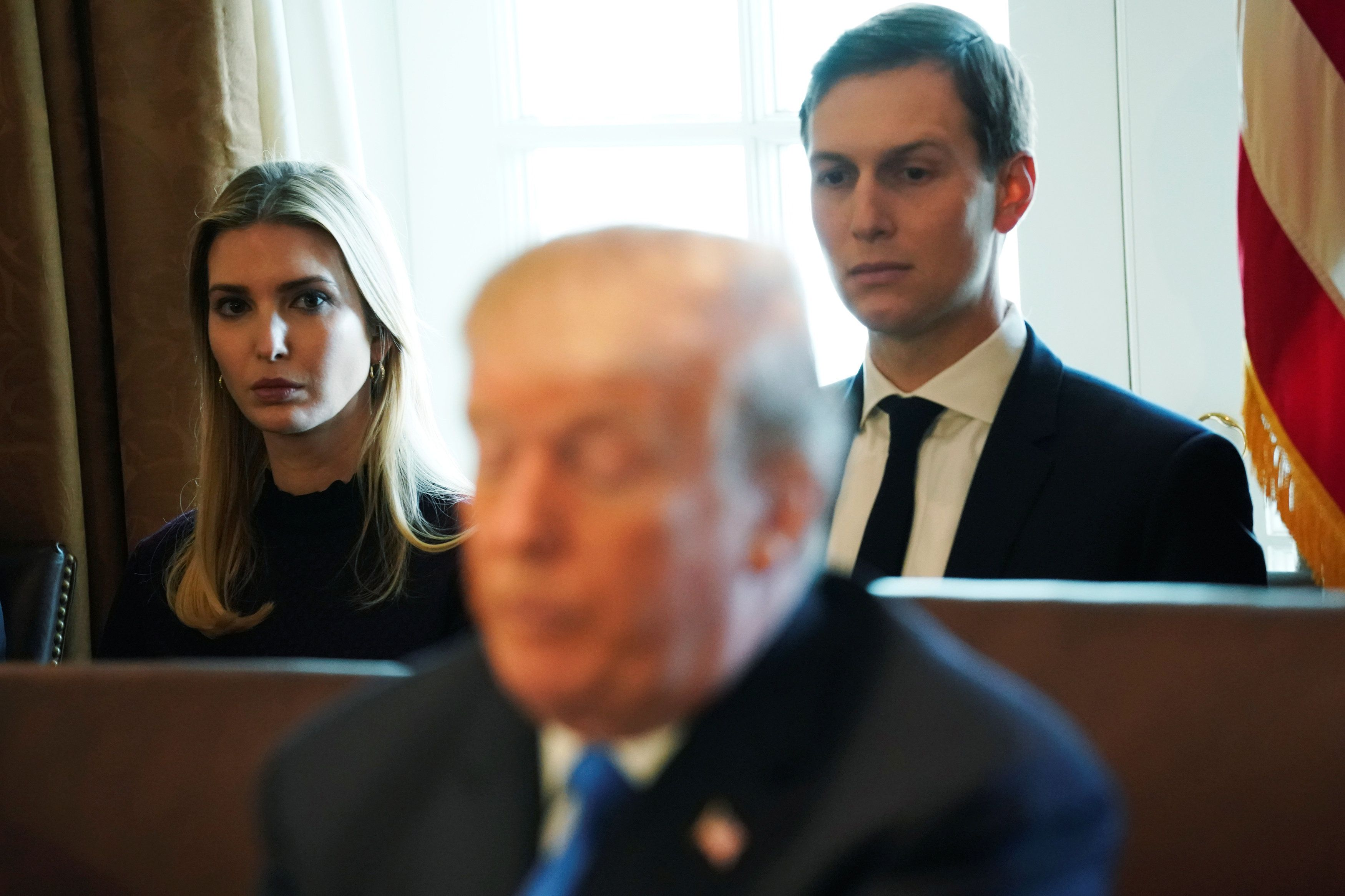 White House senior advisor Ivanka Trump and White House senior advisor Jared Kushner sit behind U.S. President Donald Trump as he talks to reporters before a cabinet meeting at the White House in Washington, U.S. December 6, 2017.  REUTERS/Jonathan Ernst