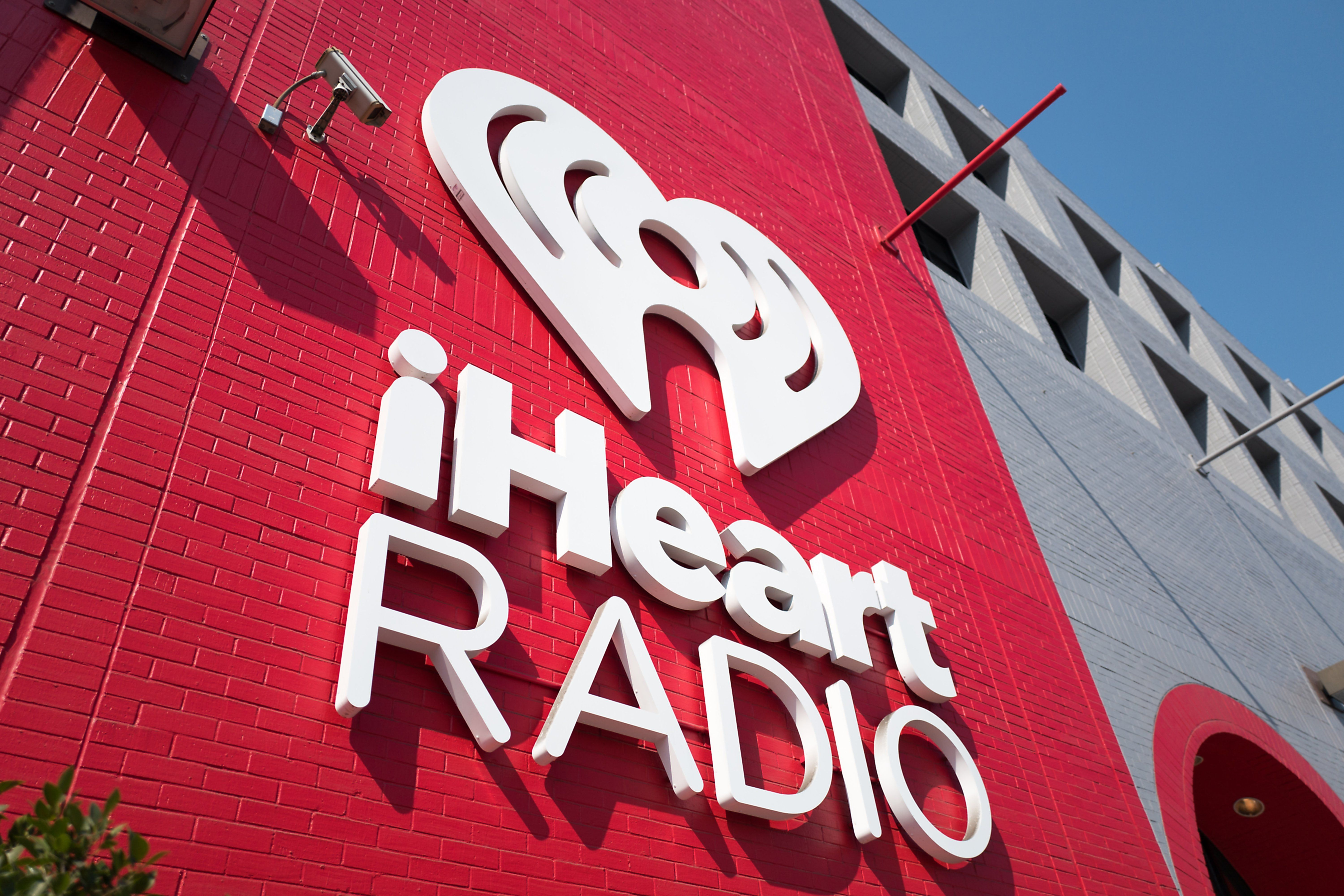 Sign for iHeartRadio music radio, part of the iHeartMedia company, at the company's local headquarters in the South of Market (SoMa) neighborhood of San Francisco, California, October 13, 2017. (Photo by Smith Collection/Gado/Getty Images)