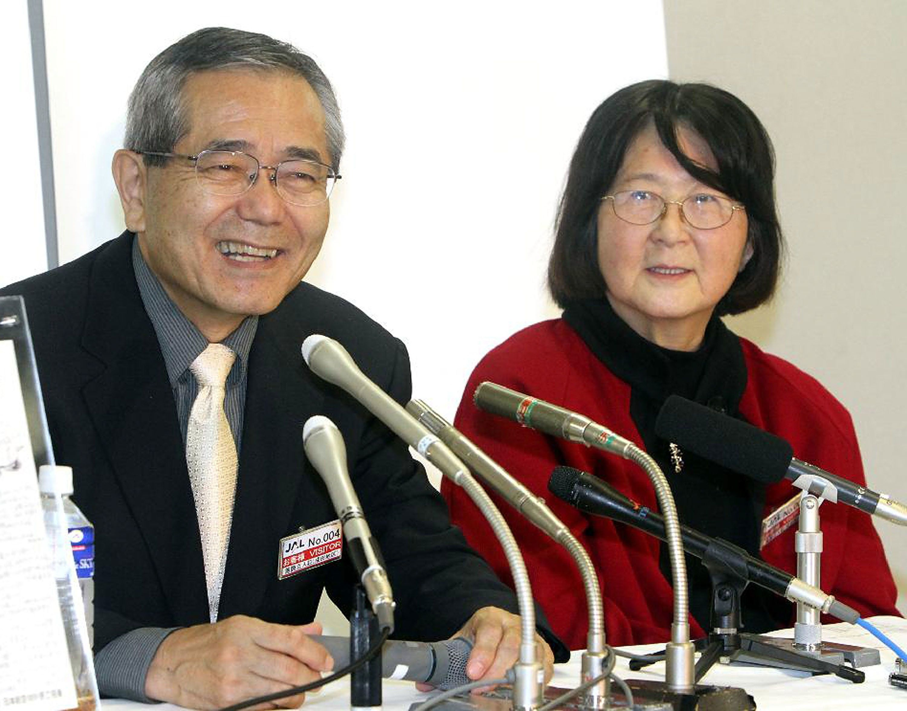 NARITA, JAPAN - OCTOBER 31:  (JAPANESE NEWSPAPERS OUT) Chemistry Nobel Prize winner Eiichi Negishi and his wife Sumire attend a press conference upon his arrival to Narita International Airport on October 31, 2010 in Narita, Chiba, Japan. Negishi, a researcher at Purdue University, along with Richard F. Heck and Akira Suzuki, won the Nobel for developing palladium-catalyzed cross coupling, which allows chemists to create complex chemicals.  (Photo by Sankei via Getty Images)