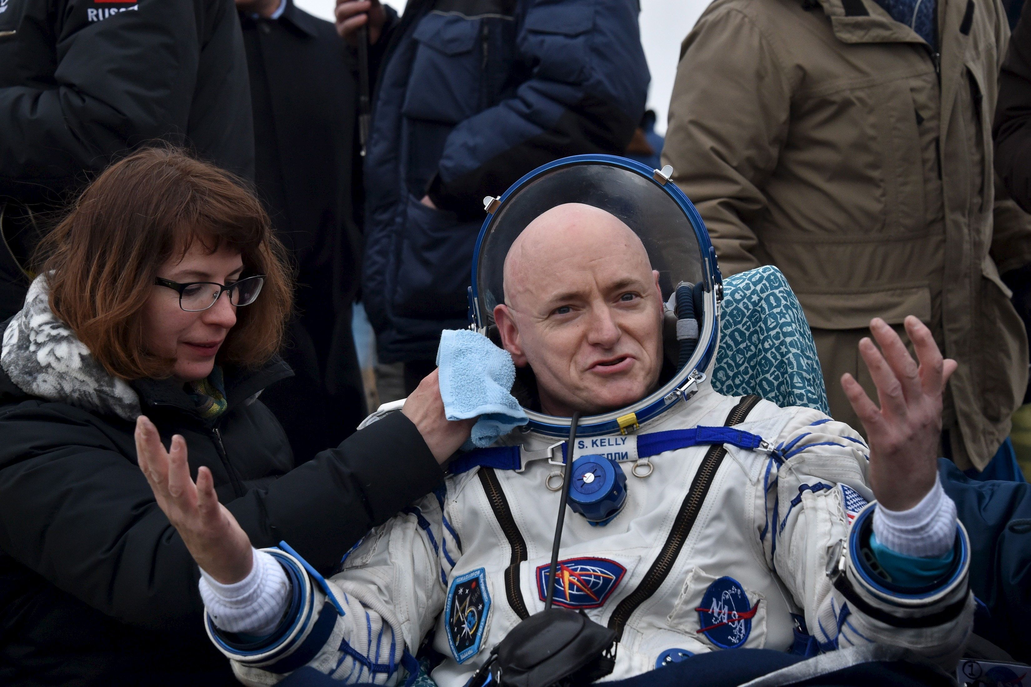 U.S. astronaut Scott Kelly reacts shortly after landing near the town of Dzhezkazgan (Zhezkazgan), Kazakhstan, March 2, 2016. REUTERS/Kirill Kudryavtsev/Pool