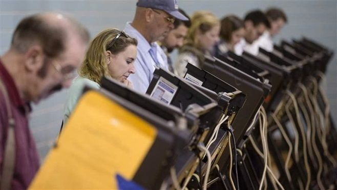 Voters use electronic voting machines at a polling place in Columbus, Ohio. Local officials across the country are trying to