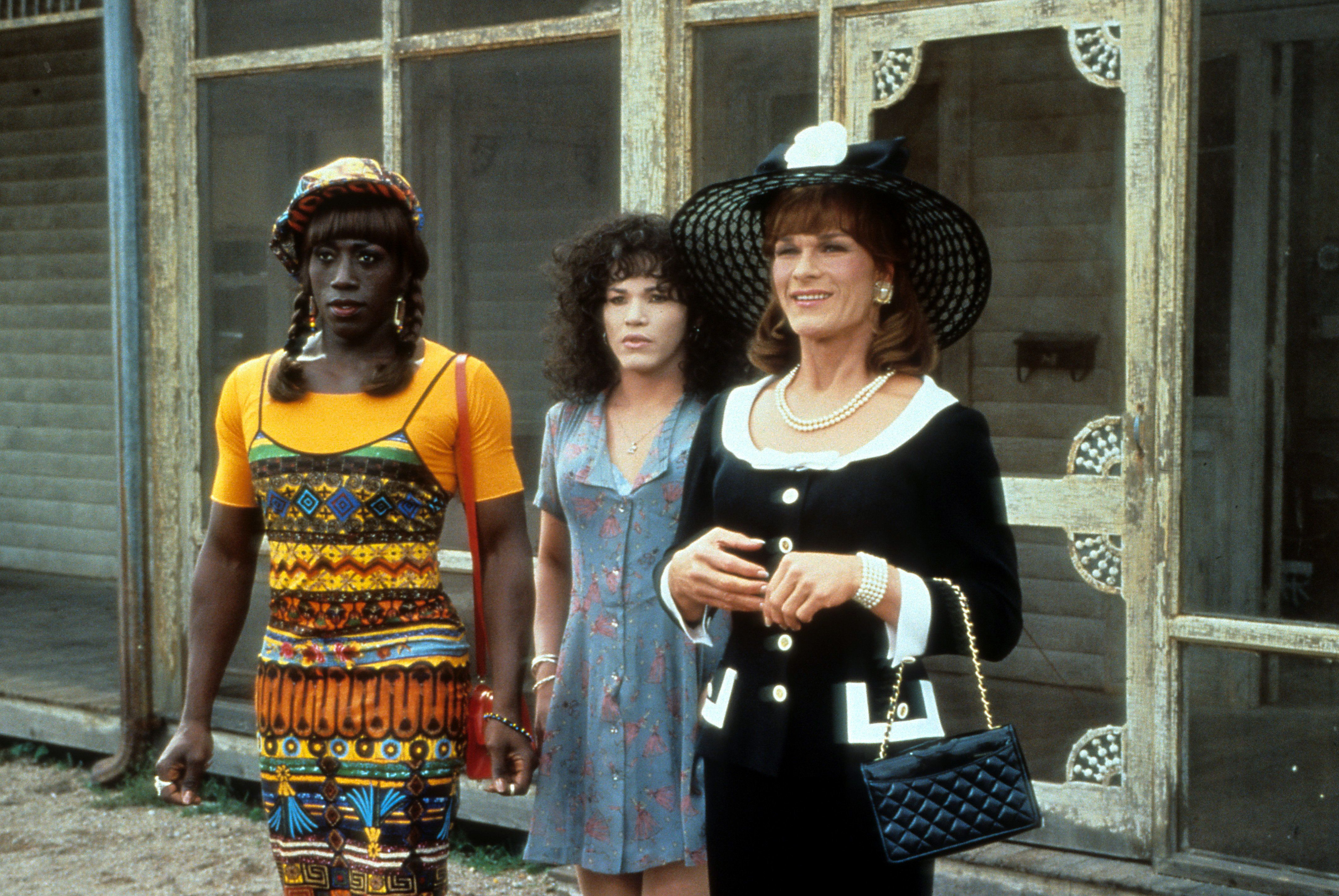 Wesley Snipes, John Leguizamo and Patrick Swayze stand outside a run down building in a scene from the film 'To Wong Foo Thanks for Everything, Julie Newmar', 1995. (Photo by Universal/Getty Images)