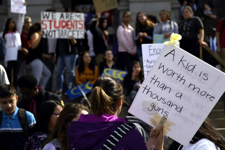 High school students at the Denver State Capitol take part in a national walkout to protest gun violence.