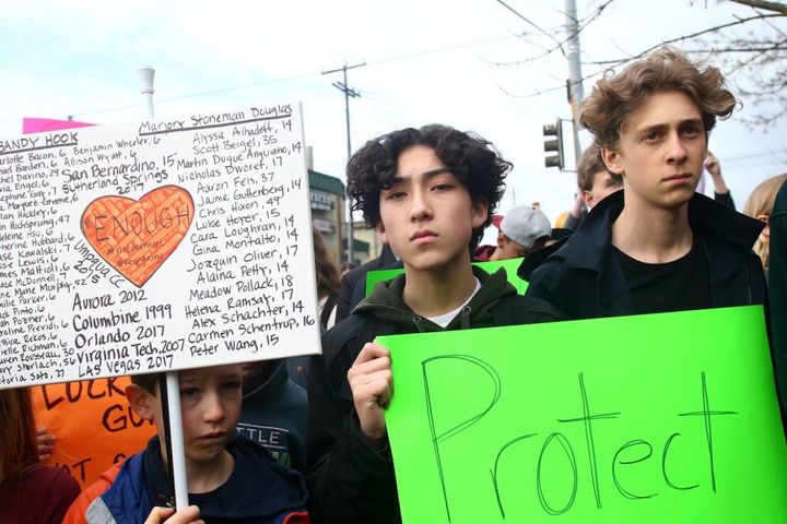 Students from Adams Elementary School and Ballard High Schooll in Seattle, Washington take part in a national walkout to prot