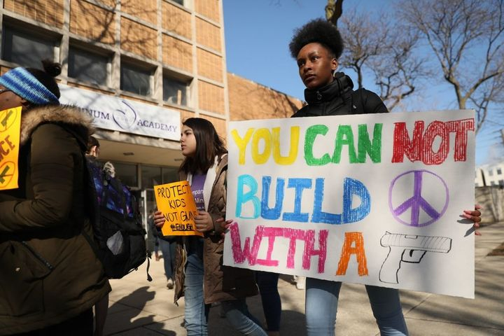 Students from Josephinum Academy in Chicago take part in a national walkout to protest gun violence.