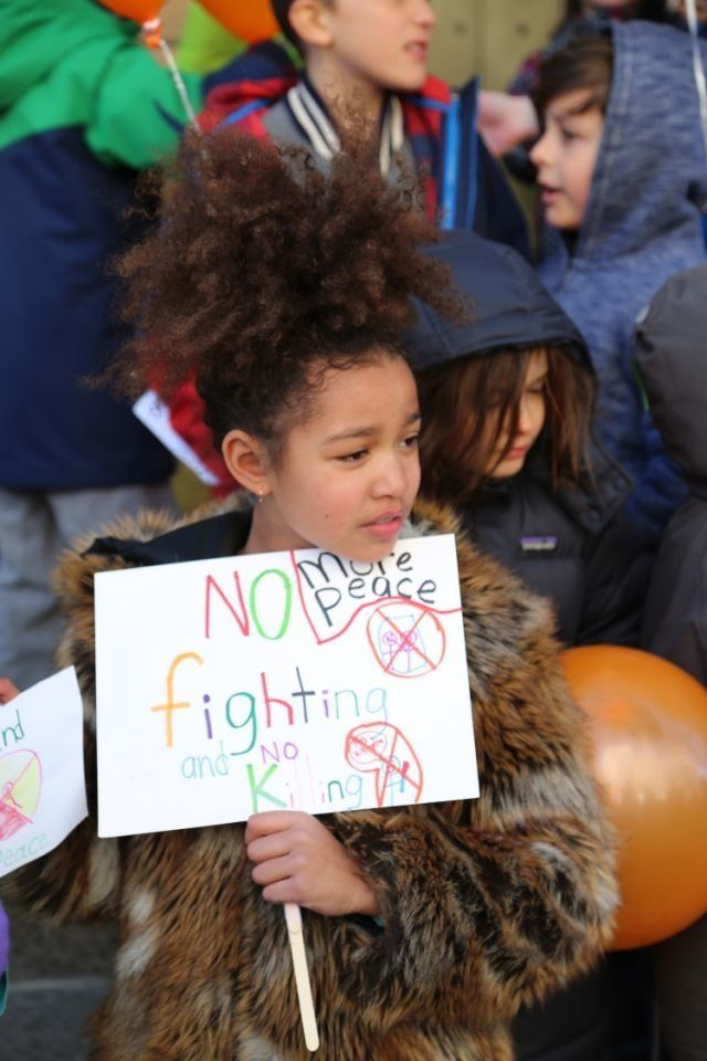 Students at Science, Language and Arts International School in Brooklyn, New York take part in a national walkout to protest