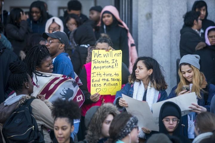 Students at Philadelphia High School of Creative and Performing Arts participate in a walkout to address school safety and gu