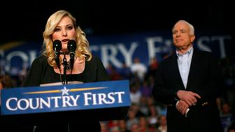 Meghan McCain introduces her father, U.S. Republican presidential nominee Sen. John McCain (R-AZ) (R), during a rally in Westerville, Ohio October 19, 2008. REUTERS/Carlos Barria (UNITED STATES) US PRESIDENTIAL ELECTION CAMPAIGN 2008 (USA)