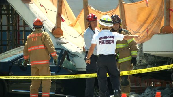 This AFP TV video frame grab shows emergency response workers atthe collapsed pedestrian bridge.