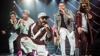 INDIANAPOLIS, INDIANA - DECEMBER 12: Nick Carter(L), Brian Littrell, AJ McLean, Howie Dorough, Kevin Richardson of the Backstreet Boys perform at Bankers Life Fieldhouse on December 12, 2017 in Indianapolis, Indiana. (Photo by Keith Griner/Getty Images)