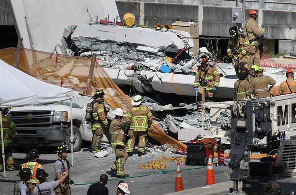 Miami-Dade Fire Rescue personnel and other rescue units work at the scene of the collapse.