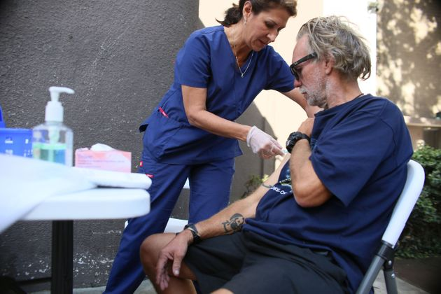 A nurse gives a hepatitis A vaccine to a homeless person in San Diego on Oct. 4,