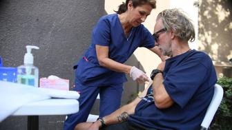 Paulina Bobenrieth a nurse with the HHSA Public Health dept. gives a Hepatitis A vaccine to a Homeless person in Downtown San Diego, CA on Wednesday, October 4, 2017.  A Hepatitis A outbreak has killed numerous homeless people and sent hundreds to the hospital.(Photo by Sandy Huffaker for The Washington Post via Getty Images via Getty Images)