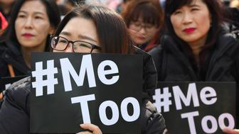 TOPSHOT - South Korean demonstrators hold banners during a rally to mark International Women's Day as part of the country's #MeToo movement in Seoul on March 8, 2018. The #MeToo movement has gradually gained ground in South Korea, which remains socially conservative and patriarchal in many respects despite its economic and technological advances. / AFP PHOTO / Jung Yeon-je        (Photo credit should read JUNG YEON-JE/AFP/Getty Images)