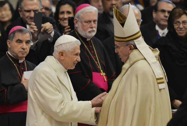Pope Francis, right, greets Pope Emeritus Benedict XVI at St. Peter's Basilica on Feb. 14, 2015.