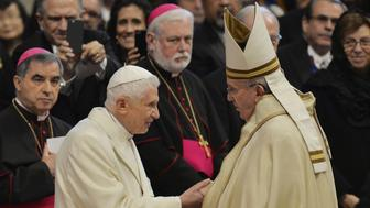 Pope Francis (R) greets Pope Emeritus Benedict XVI at the end of a consistory for the creation of new Cardinals on February 14, 2015 at St. Peter's basilica in Vatican. Pope Francis welcomes 20 new cardinals to the ranks today, including 15 who are below 80 and would therefore be entitled to vote in a conclave to decide a new pontiff in the event of something happening to the current one. AFP PHOTO / ANDREAS SOLARO        (Photo credit should read ANDREAS SOLARO/AFP/Getty Images)