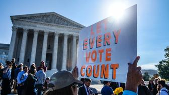 WASHINGTON, DC - OCTOBER 03:  People hold signs during a rally to call for 'An End to Partisan Gerrymandering' at the Supreme Court of the United States on October 3, 2017 in Washington, DC.  (Photo by Leigh Vogel/Getty Images)