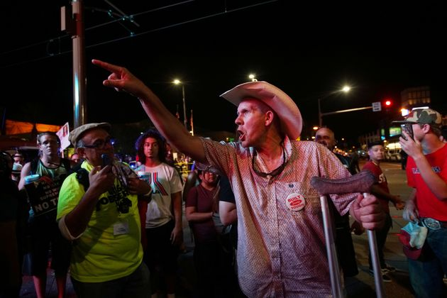 Pro-Trump supporters face off with anti-Trump protesters outside a Donald Trump campaign rally in Phoenix,...