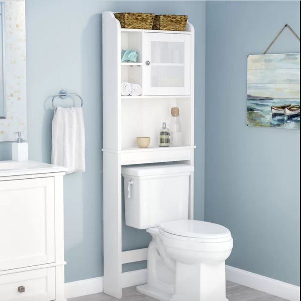 That space above your toilet can actually be useful.With open shelves, two cubbies, and a knob pull-adorned cabinet, it