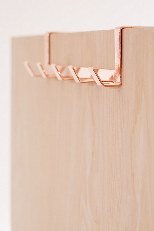 If you're in need of an organizer to hang your robe, shower cap, and towels, get this minimalist over the door hook for easy