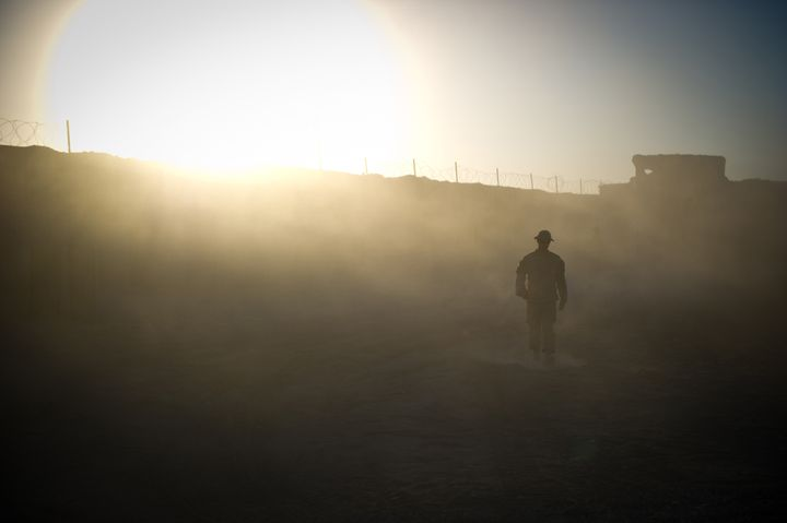 A U.S. soldier walks in the camp of Ahmed Khan near Kandahar, Afghanistan, on November 25, 2010.