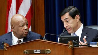 The House Oversight and Government Reform Committee, led by Chairman Darrell Issa (R-CA) (R), speaks with Representative Elijah Cummings (D-MD) at Capitol Hill in Washington June 20, 2012. The House Oversight and Government Operations Committee is considering to go ahead with plans to vote on charging U.S. Attorney General Eric Holder with contempt of Congress. REUTERS/Jose Luis Magana  (UNITED STATES - Tags: POLITICS CRIME LAW)