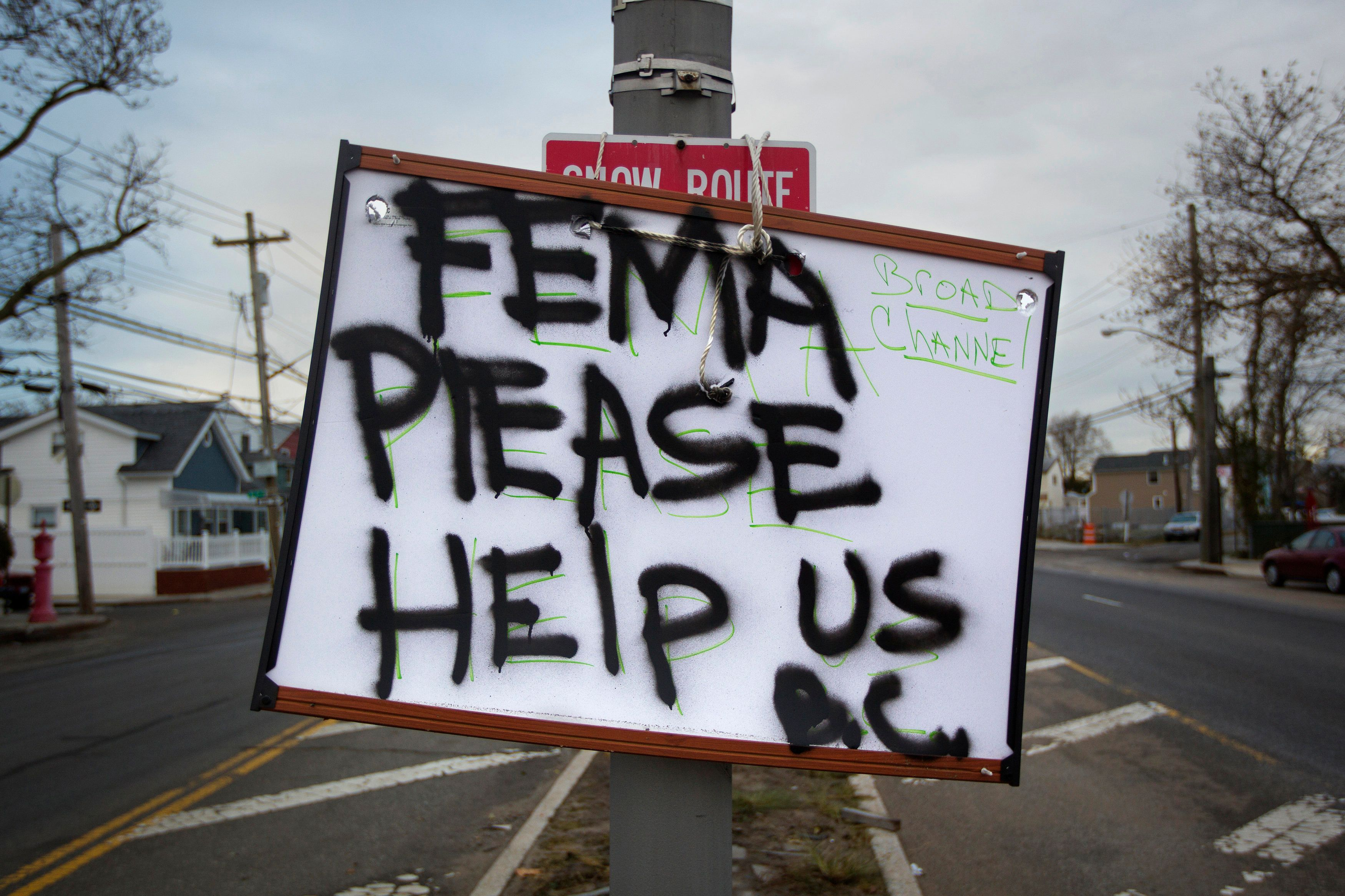 A sign asking for help from FEMA (Federal Emergency Management Agency) is seen in the BroadChannel section of the Queens borough of New York November 2, 2012. Four days after superstorm Sandy smashed into the U.S. Northeast, rescuers on Friday were still discovering the extent of the death and devastation in New York and the New Jersey shore, and anger mounted over gasoline shortages, power outages and waits for relief supplies.    REUTERS/Shannon Stapleton (UNITED STATES - Tags: ENVIRONMENT DISASTER)