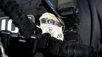 """The badge of a U.S. Immigration and Customs Enforcement's (ICE) Fugitive Operations team is seen in Santa Ana, California, U.S., May 11, 2017. REUTERS/Lucy Nicholson  SEARCH """"NICHOLSON ARREST"""" FOR THIS STORY. SEARCH """"WIDER IMAGE"""" FOR ALL STORIES."""