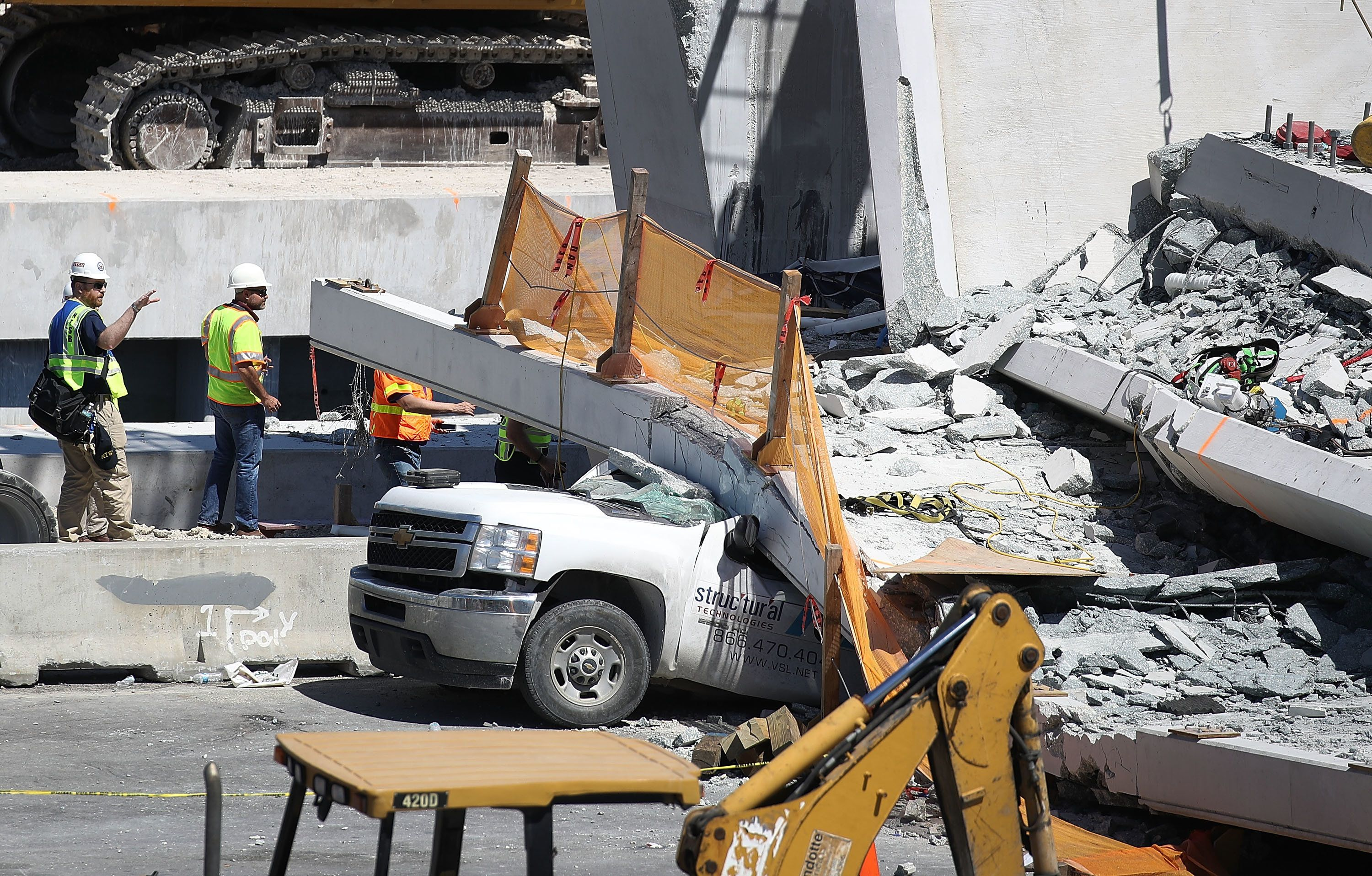 MIAMI, FL - MARCH 16:  Members of the National Transportation Safety Board investigate the scene where a pedestrian bridge collapsed a few days after it was built over southwest 8th street allowing people to bypass the busy street to reach Florida International University on March 16, 2018 in Miami, Florida. Reports indicate that there are six fatalities as a result of the collapse.  (Photo by Joe Raedle/Getty Images)