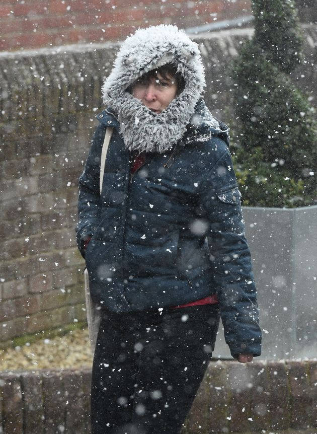 A woman walks in the snow in Salisbury, Wilts, during the 'mini beast from the east'