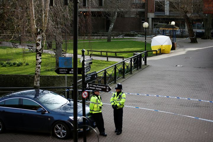 A police officer stands at a cordon around the bench where former Russian intelligence agent Sergei Skripal and his daughter Yulia were found after they were poisoned, in Salisbury, Britain March 14, 2018.