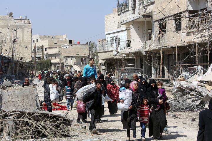 Syrian civilians evacuate from the town of Jisreen in the southern Eastern Ghouta, on the eastern outskirts of the capital Da