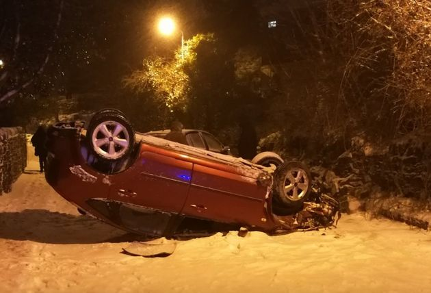 West Yorkshire Police tweeteda picture of an overturned car on Healthy Lane, Halifax. The road...