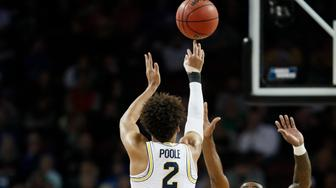 WICHITA, KS - MARCH 17: Jordan Poole #2 of the Michigan Wolverines takes a shot against the Houston Cougars in the second round of the 2018 NCAA Men's Basketball Tournament held at INTRUST Arena on March 17, 2018 in Wichita, Kansas. (Photo by David Klutho/NCAA Photos via Getty Images)