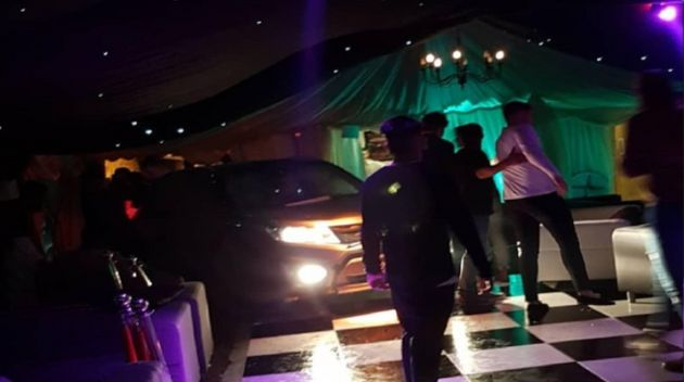 A man has been arrested onon suspicion of attempted murder after a vehicle was driven on to a dancefloor...