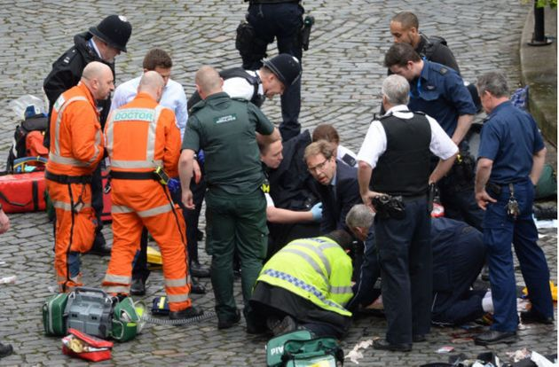 MP Tobias Ellwood pictured, middle, trying to save the life of Pc Keith