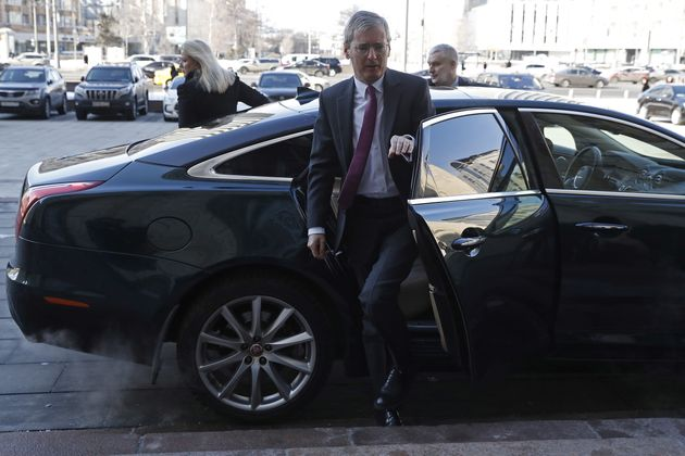 British ambassador to Russia Laurie Bristow (C) outside the offices of the Russian Foreign Ministry in...