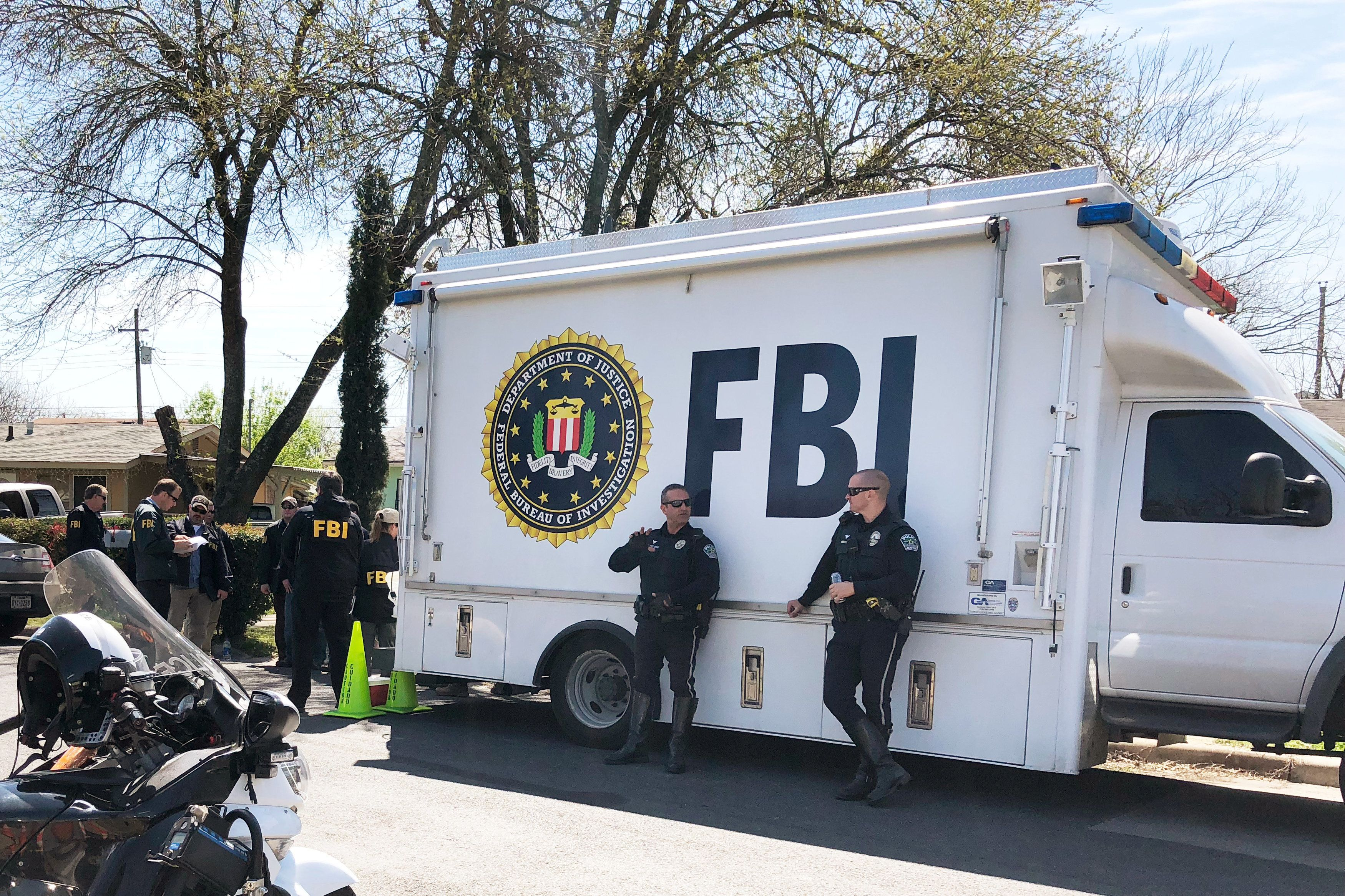 Law enforcement personnel including FBI agents are seen near a home that was hit with a parcel bomb in Austin, Texas, U.S., March 13, 2018.   REUTERS/Jon Herskovitz