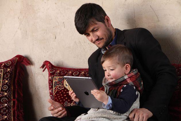 Sayed Assadullah Puja mit Sohn 'Donald