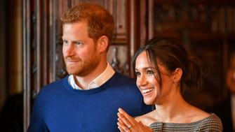 Britain's Prince Harry and his fiancee Meghan Markle watch a performance by a Welsh choir in the banqueting hall during a visit to Cardiff Castle in Cardiff, Britain, January 18, 2018. REUTERS/Ben Birchall/Pool