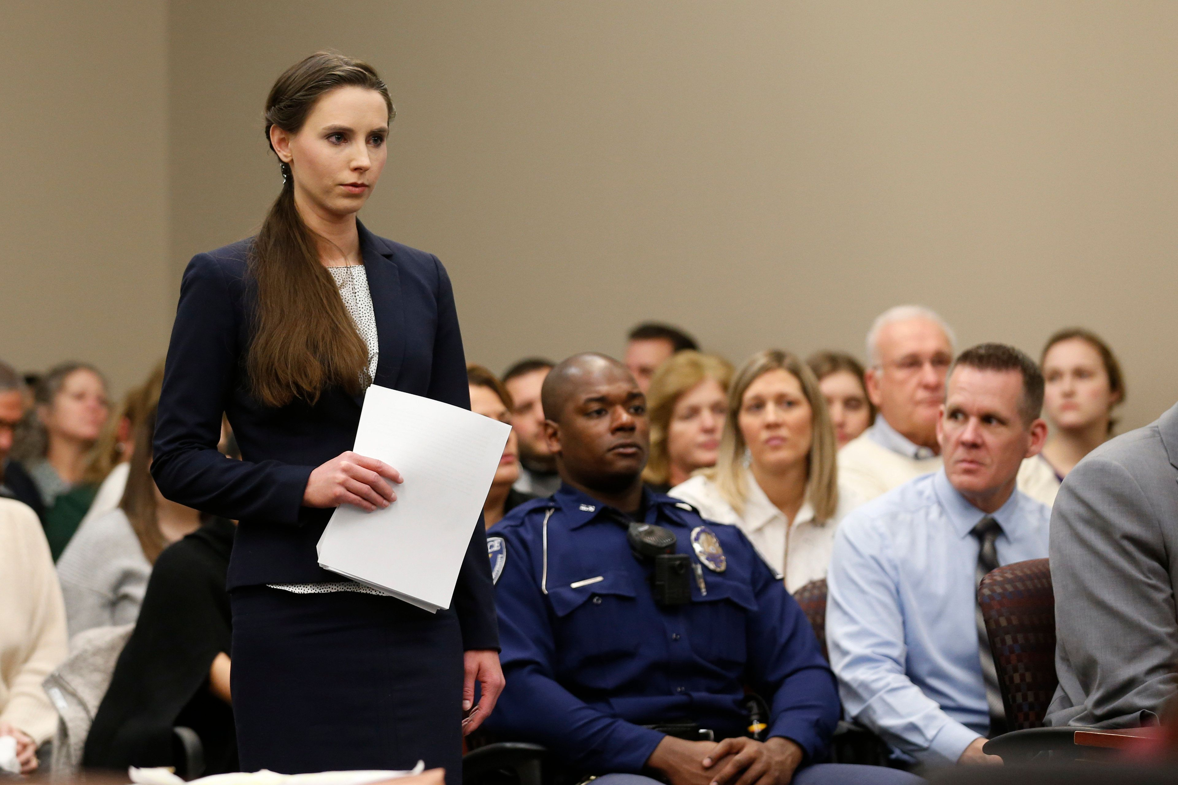 Rachael Denhollander speaks as former Michigan State University and USA Gymnastics doctor Larry Nassar listens to impact statements during the sentencing phase in Ingham County Circuit Court on January 24, 2018 in Lansing, Michigan. More than 100 women and girls accuse Nassar of a pattern of serial abuse dating back two decades, including the Olympic gold-medal winners Simone Biles, Aly Raisman, Gabby Douglas and McKayla Maroney -- who have lashed out at top sporting officials for failing to stop him.    / AFP PHOTO / JEFF KOWALSKY        (Photo credit should read JEFF KOWALSKY/AFP/Getty Images)