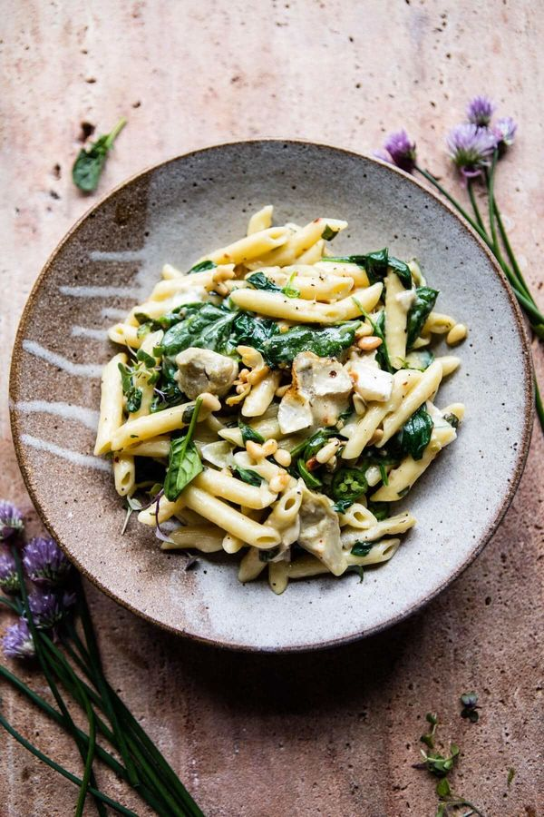 "<strong>Get the <a href=""https://www.halfbakedharvest.com/lemony-spinach-and-artichoke-brie-penne-pasta/?highlight=pasta"" tar"