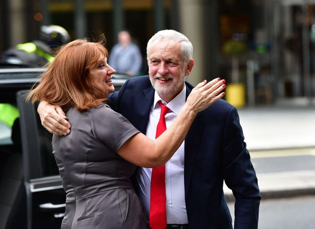 Jeremy Corbyn gets a huge from Office Director Karie Murphy after the 2017